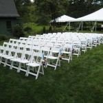 White Wood Folding Chair with White Padded Seat